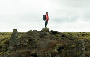 grace leigh ryser with nomatic bag in iceland