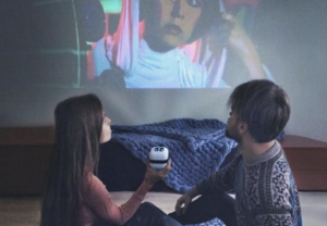 couple watching star wars with the mini cinemood projector