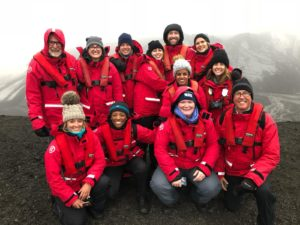 A group of people in red coats in Antarctica