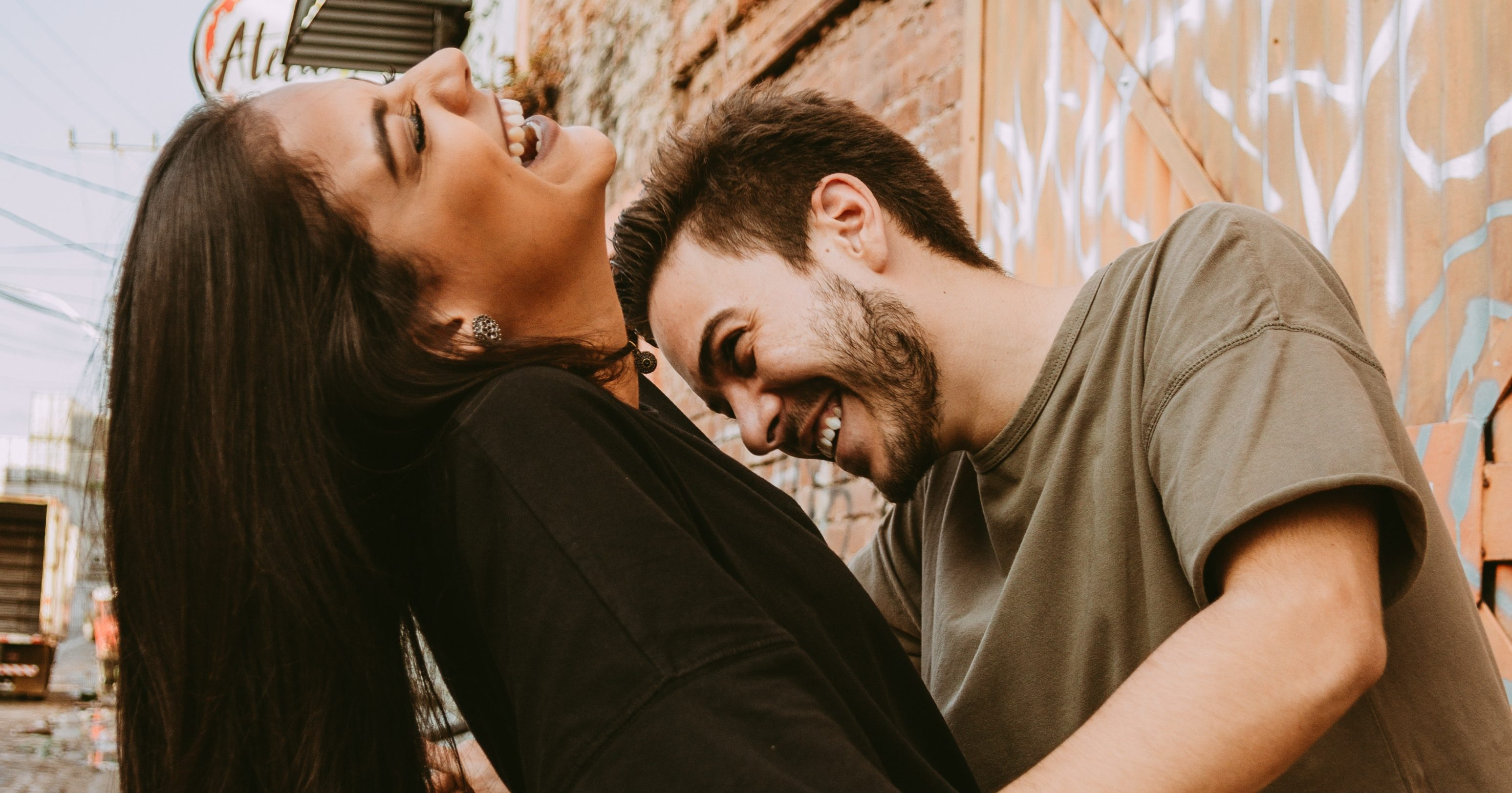 Couple in urban environment laughing