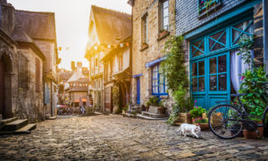 Old town in Europe at sunset with retro vintage Instagram style filter and lens flare effect.